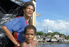 Group portrait of boy with mother in Brazilian slum Stock Images
