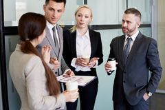 Business Team Chatting at Coffee Break stock photo