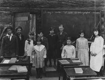 Group portrait of children standing in classroom Royalty Free Stock Photo