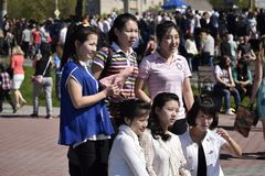 Group portrait of Chinese girls on the celebration of Victory Day in the Russian city Stock Images
