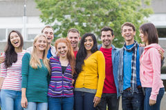 Group portrait of college students in park royalty free stock image