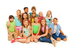 Group portrait of cute preteens. Group portrait of large group of preteens sitting isolated on white Stock Images