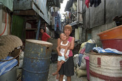 Group portrait of Filipino mother with disabled child. Philippines, island Luzon in the slum Malate in the capital Manila poses a woman with her mentally and Royalty Free Stock Photos