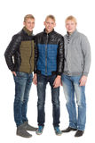 Group portrait of friends in full growth. Two of the boys twin brothers Stock Image