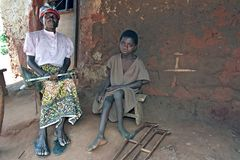 Group portrait of Ghanaian grandma and grandchild. Ghana, Region Brong Ahafo, village Tuobodom: portrait of proud old woman with his grandchild. The girl, child Royalty Free Stock Photos