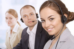 Group portrait of happy customer service people. With focus on a female customer service representative Royalty Free Stock Photography
