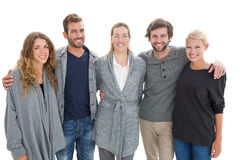 Group portrait of happy people standing with arms around Royalty Free Stock Photo