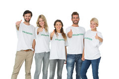 Group portrait of happy volunteers gesturing thumbs up stock photography