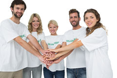 Group portrait of happy volunteers with hands together Royalty Free Stock Photos