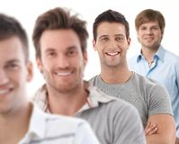 Group portrait of happy young men. Looking at camera, smiling royalty free stock photos