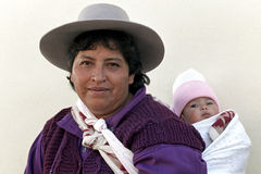 Group portrait Indian mother and child, Argentina. Indian woman with her child tied on her back in the northern Argentine village Abra Pampa, province Jujuy Stock Image