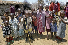 Group portrait of Maasai children, Kenya. The group of kids live together in a boma and are part of an extended family. The boys and girls wear traditional Stock Image