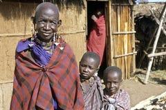 Group portrait Maasai grandma and grandchildren. Kenya, Masai Mara, Rift Valley, Serengeti, village Narooswa: Masai family portrait, Grandmother and royalty free stock images