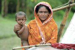 Group portrait, mother and child, boat nomads. Bangladesh, village and island kalaiya in the Bay of Bengal: A Bangladeshi woman in traditional colorful dress Royalty Free Stock Photography