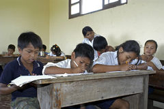 Group Portrait Of Bolivian Children Writing In The Royalty Free Stock Image