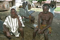 Group portrait of old Ghanaian men and young kids Royalty Free Stock Images