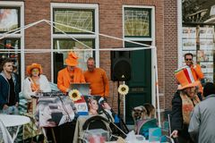 Group portrait of people in orange, crazy look, street activities for King`s Day festivity in the Netherlands Stock Image
