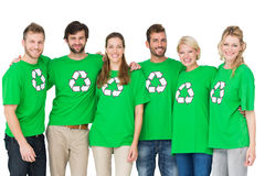 Group portrait of people wearing recycling symbol tshirts. Group portrait of young people wearing recycling symbol tshirts over white background Royalty Free Stock Photography