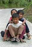 Group portrait of playing boys, Philippines. In the City Banaue Children play with their self-made skateboard. They fly, skate, hard downhill and have a lot of Stock Images