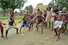 Group portrait playing boys with tops, Bangladesh Royalty Free Stock Photo