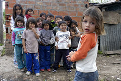 Group portrait of playing children, Argentina. Argentine Children, boys and girls, from the second largest slum in Latin America, La Cava, play together in their Royalty Free Stock Photos