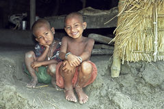 Group portrait of poor Bangladeshi children. Bangladesh, Charburhan village on the island Charkajal, Bay of Bengal: close-up of Bengali kids, boy and girl Stock Image