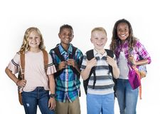 Group portrait of pre-adolescent school kids smiling on a white background royalty free stock photo