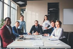 Group portrait of a professional business team looking confidently at camera.  stock photo