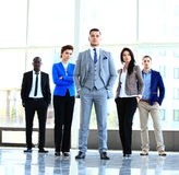 Group portrait of a professional business team looking confidently Stock Photos