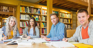 Group portrait of students at college desk Royalty Free Stock Photography