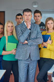 Group portrait of teacher with students Stock Image