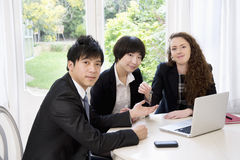 Group portrait of three businesspeople Stock Image
