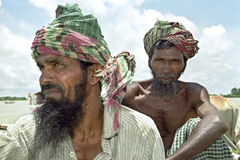 Group portrait of worrisome Bangladeshi peasants. Bangladesh, Charburhan village on the island of Charkajal, Bay of Bengal closeup of Bangladeshi farmers, men royalty free stock photos