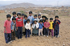 Group portrait of young Bolivian children, Bolivia. Bolivian kids, boys and girls, living in a poor, dry, suburb of the city Cochabamba. city of Cochabamba Royalty Free Stock Photos