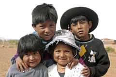 Group portrait of young Bolivian children, Bolivia. Bolivian kids, boys and girls, living in a poor, dry, suburb of the city Cochabamba. This Indian, native Stock Image