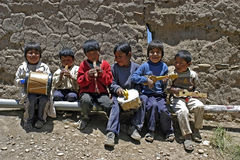 Group portrait of young Bolivian musical children. Bolivia, Huanuni village: group portrait of Indian Schoolboys, classmates, that makes music on the playground Royalty Free Stock Photo