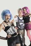 Group portrait of young female punk with senior couple standing in background Stock Image