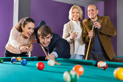 Group of  positive friends playing billiards Stock Image