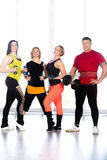 Group of positive sporty bodybuilders doing weight training in g Stock Images