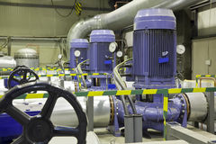 Group of powerful pumps. In modern boiler-house Stock Photos