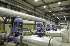 Group of powerful pumps. In modern boiler-house Stock Photography