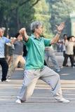 Group practice Tai Chi in Ritan Park, Beijing, China Stock Photos