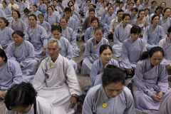 Buddhist group prayer during Buddhist funeral Stock Image