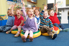 Group Of Pre School Children Answering Question In Classroom Royalty Free Stock Photography