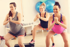 Group of pregnant women during fitness class stock images