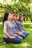 Group of pregnant women wearing the same clothes Royalty Free Stock Images