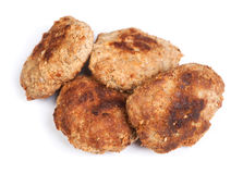 Group of prepared small hand made cutlets. Isolated over white stock photography