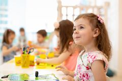 Group of preschool children engaged in drawing and crafts. Group of preschool kids engaged in drawing and crafts stock photography