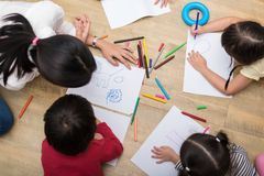 Group of preschool student and teacher drawing on paper in art c. Lass. Back to school and Education concept. People and lifestyles theme. classroom in nursery royalty free stock photo