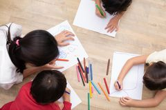 Group of preschool student and teacher drawing on paper in art c. Lass. Back to school and Education concept. People and lifestyles theme. classroom in nursery royalty free stock photography